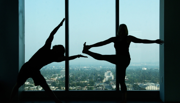 Yoga masters Rich Tola and Jessi Harper teaching a charity class in Hollywood to benefit The Boulevard Zen Foundation